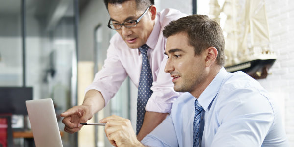 an employee benefits broker shows a client what his claims data means